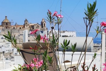 Panoramic view of Ostuni old town and the blue Adriatic sea from Casa dei Fiori holiday rental home rooftop terrace