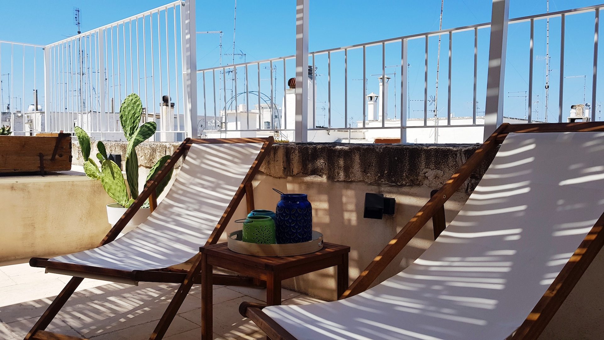 Shaded lower upper terrace with lounge chairs at Casa Emma holiday rental home in Ostuni