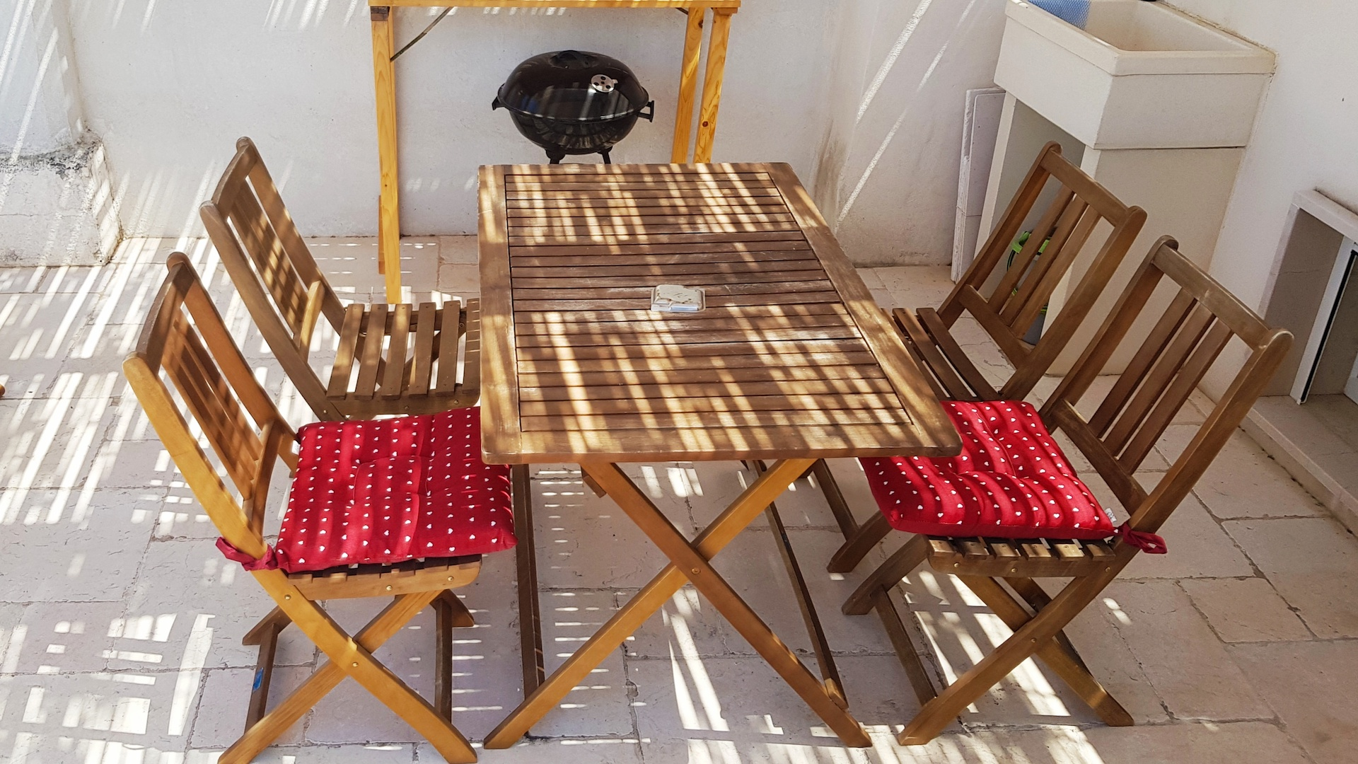 Dining facilities on the lower rooftop terrace at Casa Emma holiday rental home in Ostuni Puglia