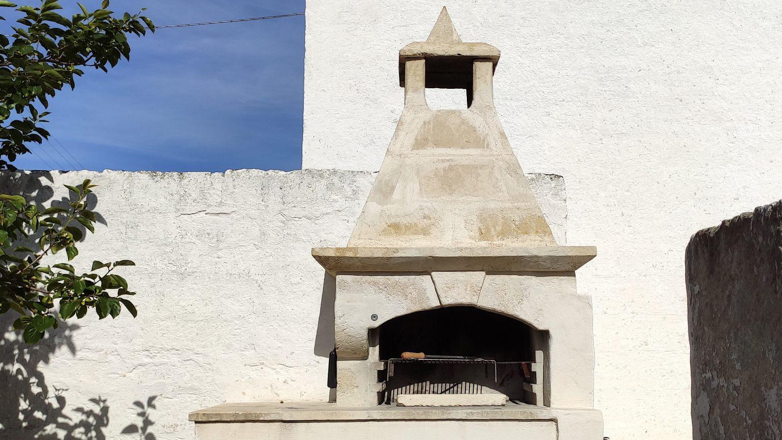 Stone BBQ at Masseria Bellavista Ostuni Vacation holiday rental villa in Puglia with pool and seaview