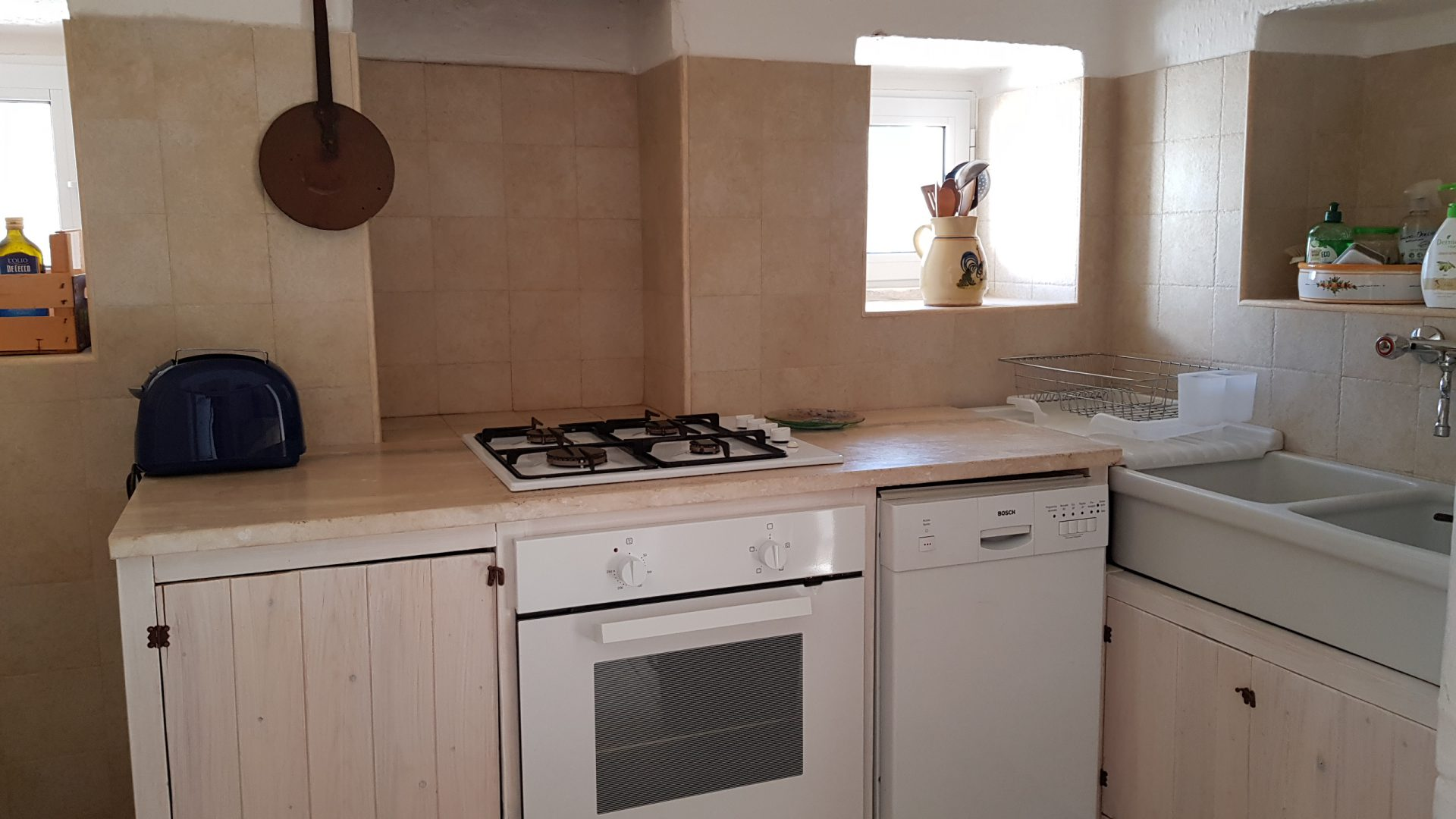 Elegant and well-equipped kitchen at Masseria Bellavista Ostuni Vacation holiday rental villa in Puglia with pool and seaview