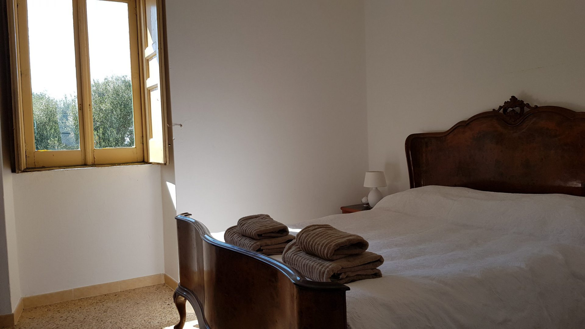 Second queen size bedroom in Masseria Bellavista Ostuni Vacation holiday rental villa in Puglia with pool and seaview