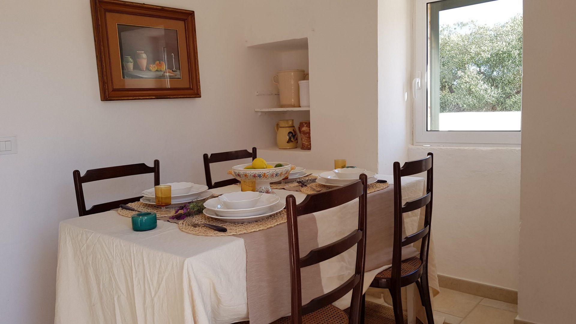 The dining area at Masseria Bellavista Ostuni Vacation holiday rental villa in Puglia with pool and sea view