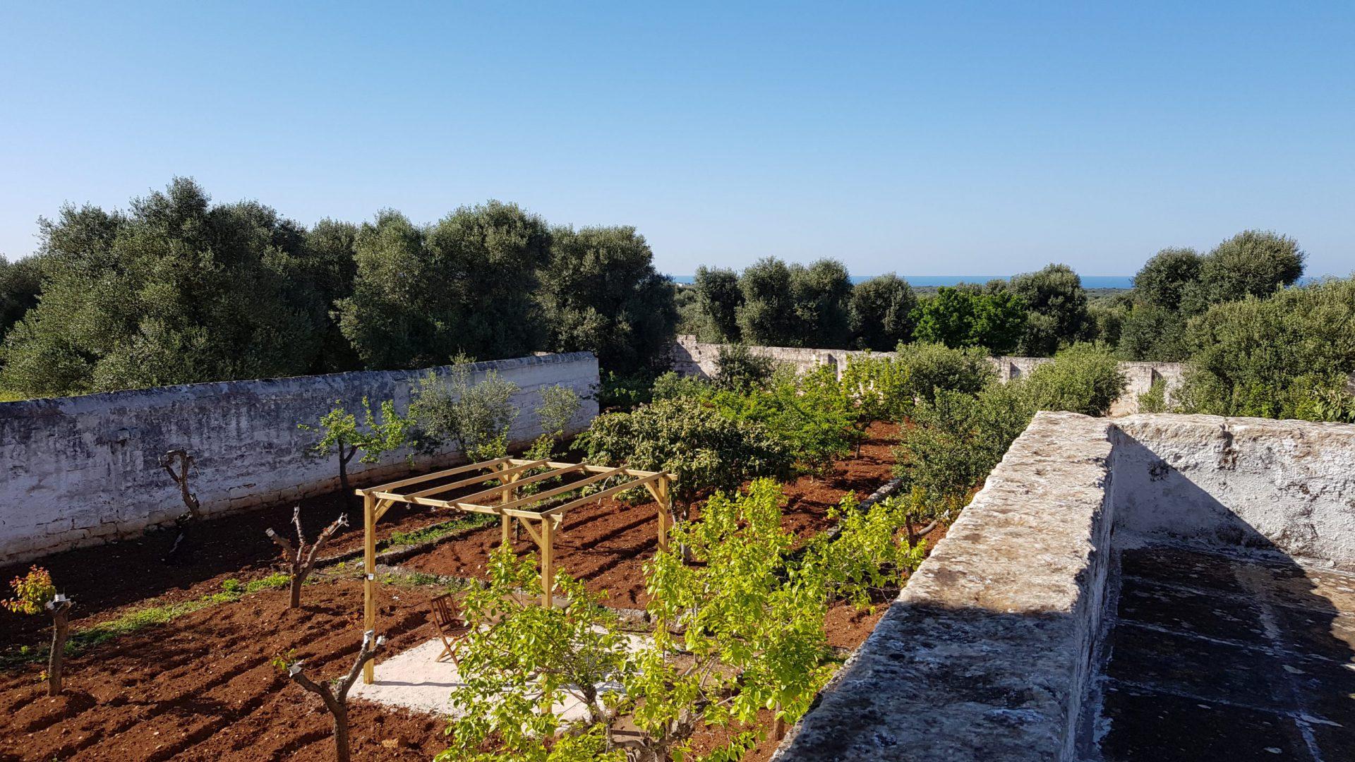 Garden and gazebo and sea view at Masseria Bellavista Ostuni Puglia holiday vacation rental villa