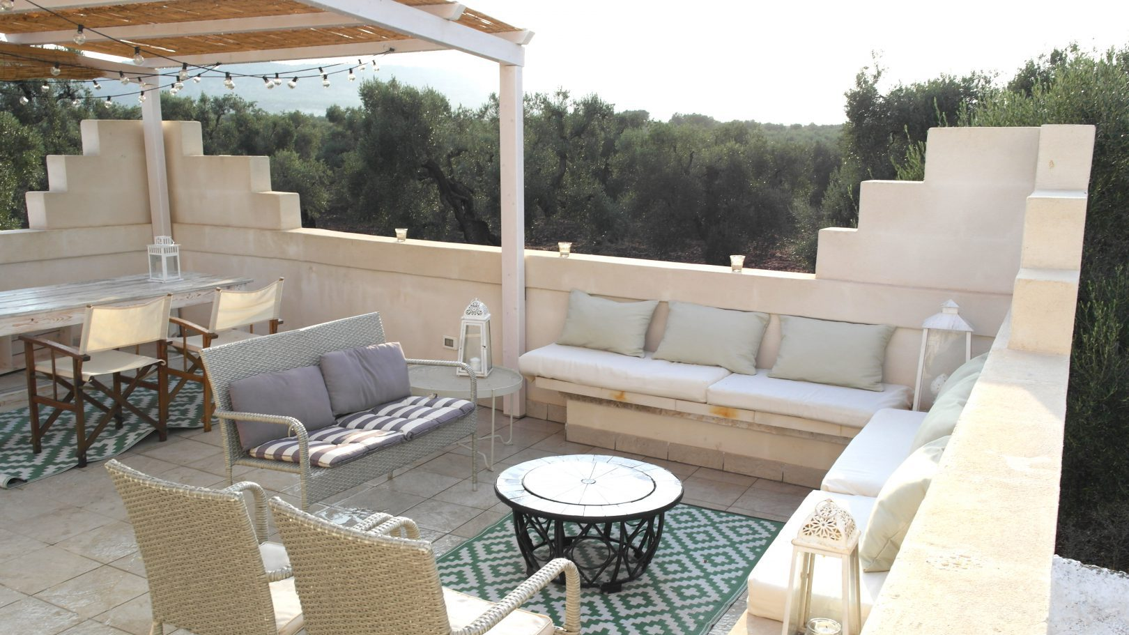Cozy outdoor private terrace next to the swimming pool at Masseria Bellavista historic holiday vacation rental villa in ostuni puglia with seaview