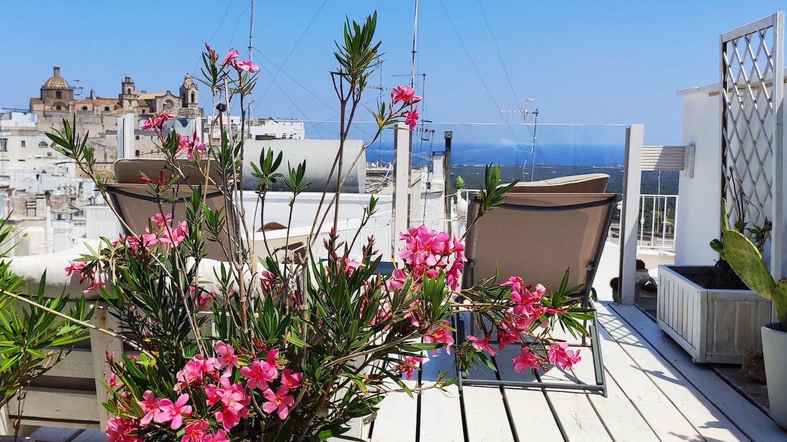 view of Ostuni historical centre and the blue Adriatic sea at Casa dei Fiori holiday vacation rental home in Puglia