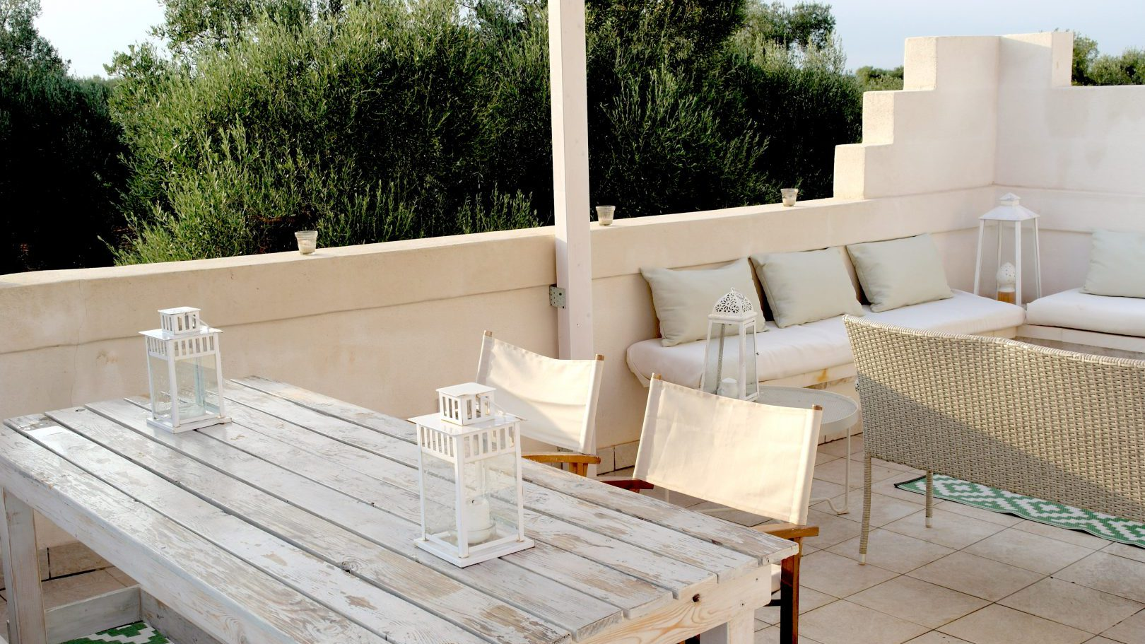 Lounge or dine at your private terrace/patio at Masseria Bellavista Ostuni vacation holiday rental villa in Puglia with pool and seaview