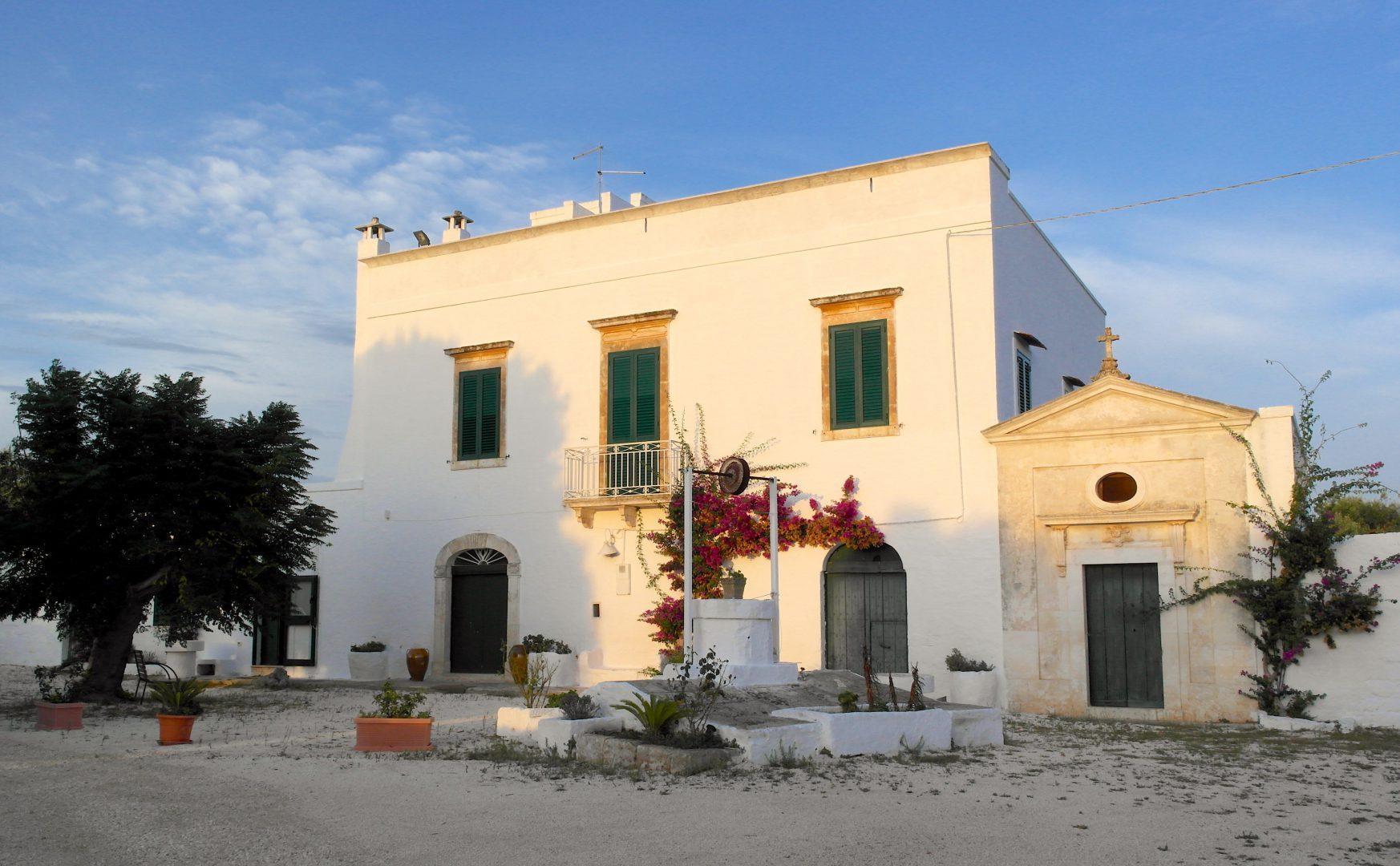 Masseria Bellavista historic holiday vacation rental villa in ostuni puglia with seaview pool at dusk