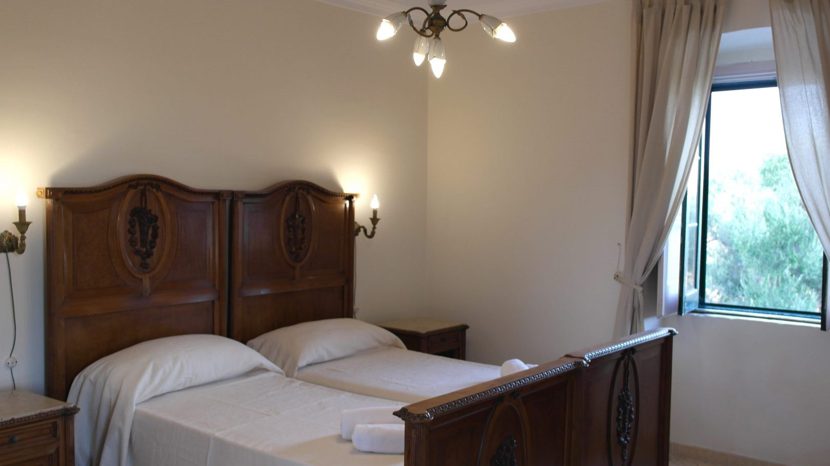 Large bedroom with twin beds in Masseria Bellavista Ostuni Vacation holiday rental villa in Puglia with pool and seaview